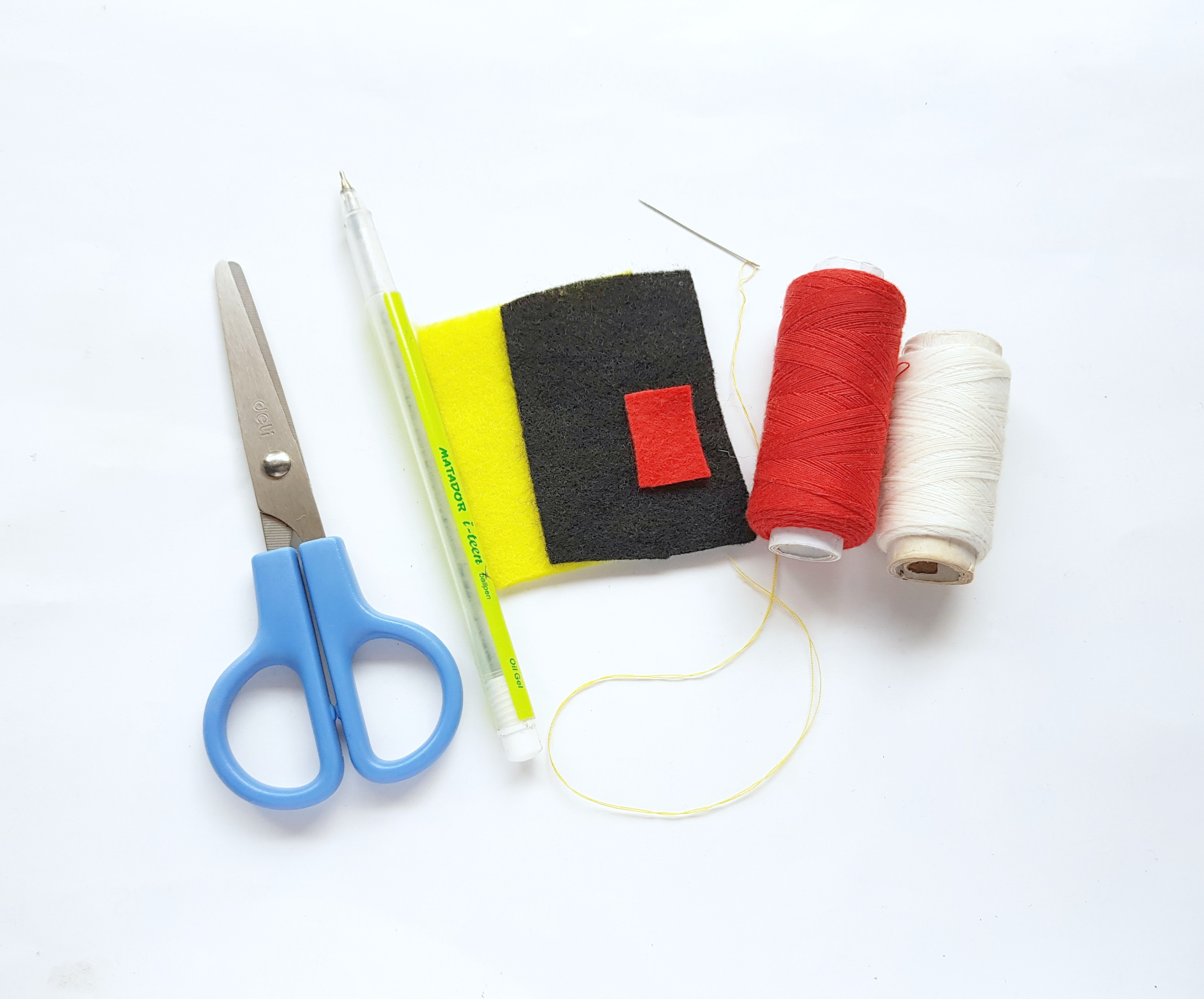 A picture of supplies needed to make a felt Pikachu: scissors, pen, felt in yellow, red, white, and black, and a needle and thread.