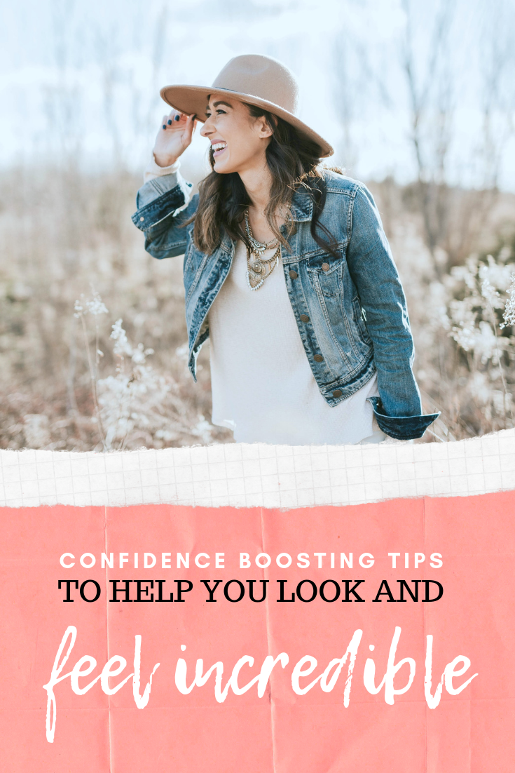 "A woman smiles happily and confidently in a field, below her is a banner that reads, ""Confidence boosting tips to help you look and feel incredible""."