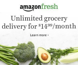 Green vegetables are shown against a white background. Banner reads Amazon Fresh Unlimited Grocery for $14.99.