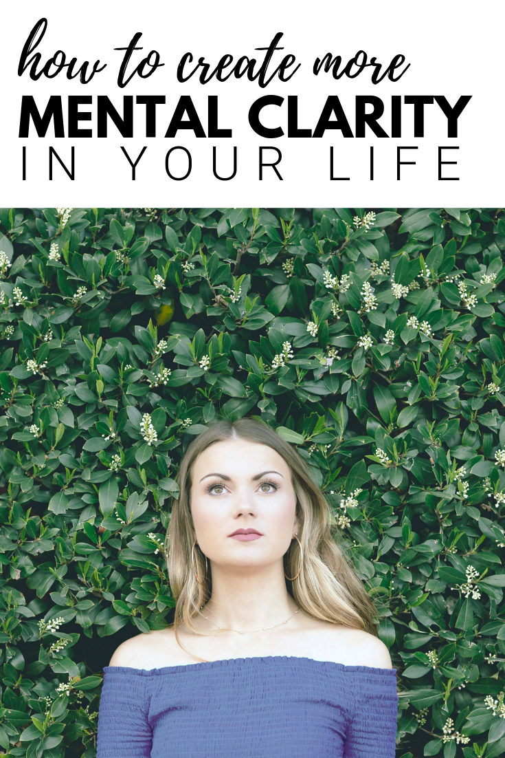 "A banner reads, ""How to create mental clarity in your life,"" a picture of a Woman stands in front of a green live plant wall, looks up pensively."