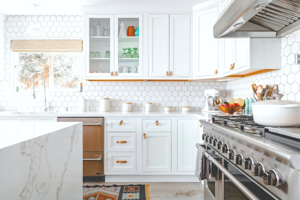 A beautiful kitchen shes the fittings and cabinets that are modern yet rustic.