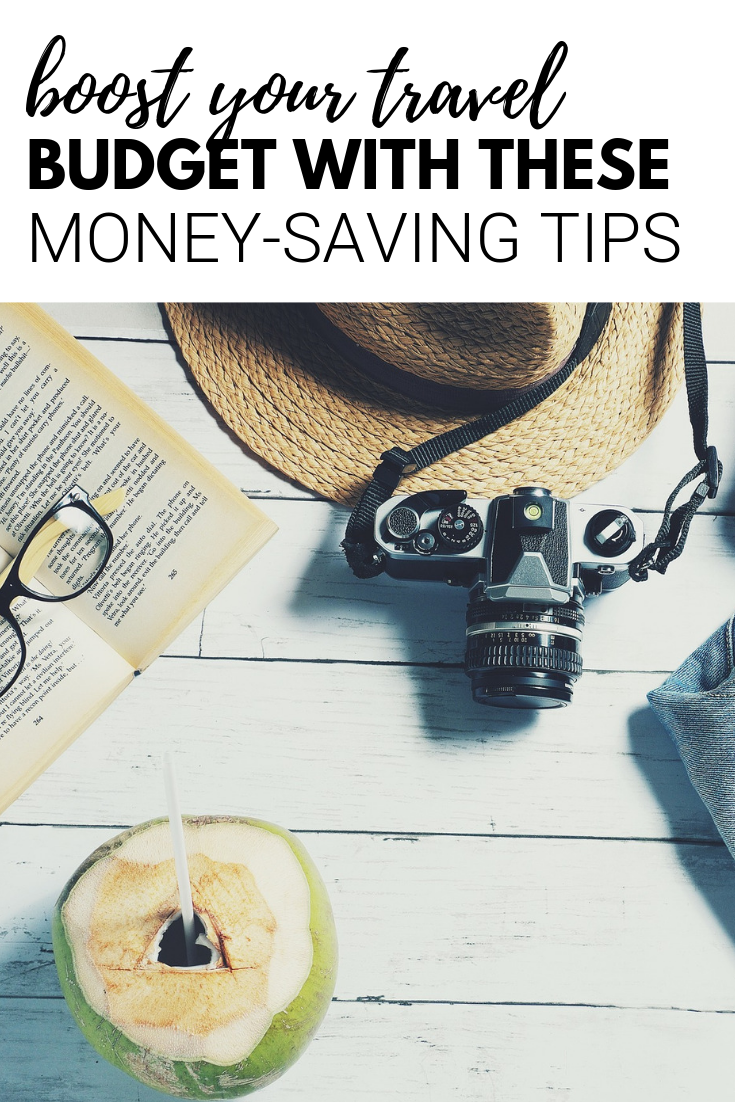 "A banner reads, ""boost your travel budget with these money-saving tips,' and below is a picture of travel must-haves like a camera, hat, and more."