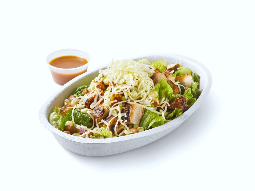 A salad bowl from Chipotle Mexican Grill is pictured against a white background.
