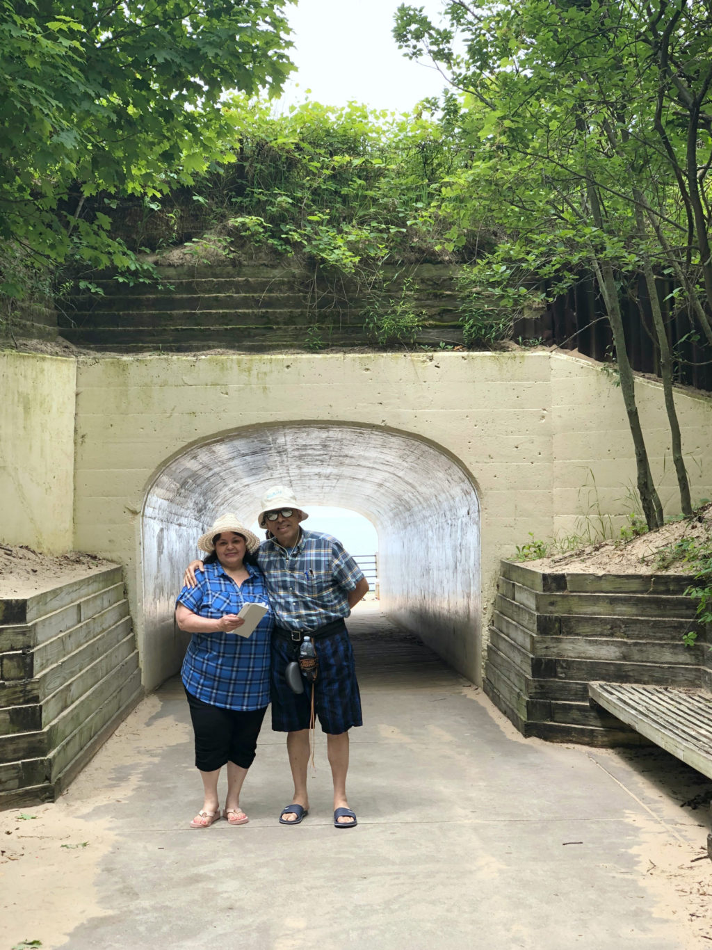 Nancy's parents, Milagro and Francisco pose in front of the tunnel at Tunnel Beach in Holland, MI.