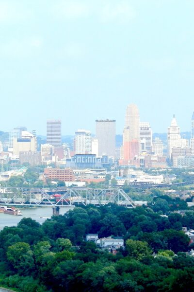 Skyline in Cincinnati, Ohio is shown in the distance and a waterway is in focus.