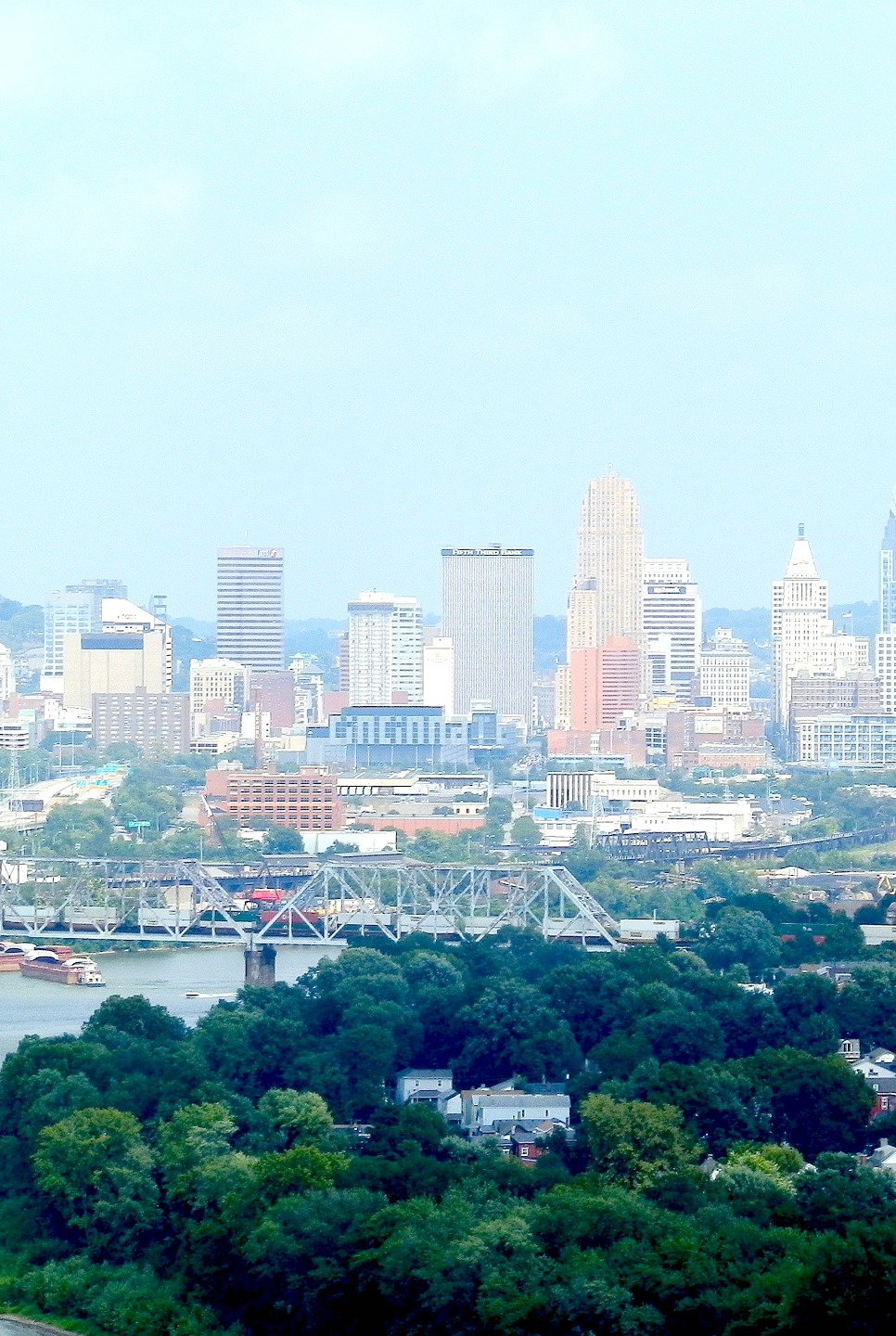 Skyline in Cincinnati, Ohio is shown in the distance and a waterway is in focus. Here's why you plan a trip to Ohio.