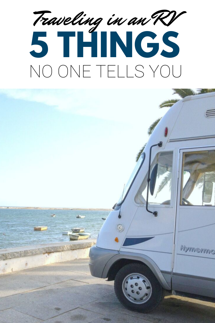 "A banner reads, ""traveling in an RV, 5 things no one tells you,"" a tip of an RV is shown parked by a waterfront that is lined by many boats."