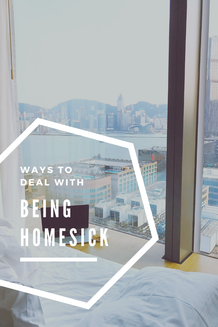 "A banner reads, ""ways to deal with being homesick,"" and shows a picture of an empty bed overlooking a city from a hotel window."