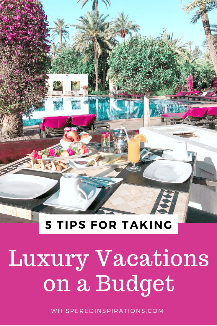 "A luxury hotel pool with a table filled with food. A banner below it reads, ""5 tips for taking luxury vacations on a budget.'"