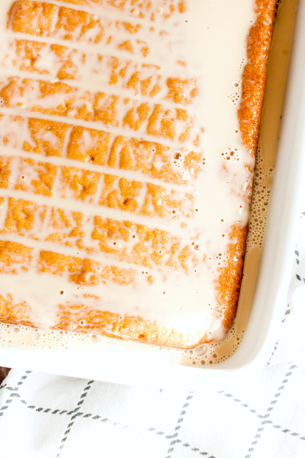 Tres Leches cake is soaked in creamy mixture.