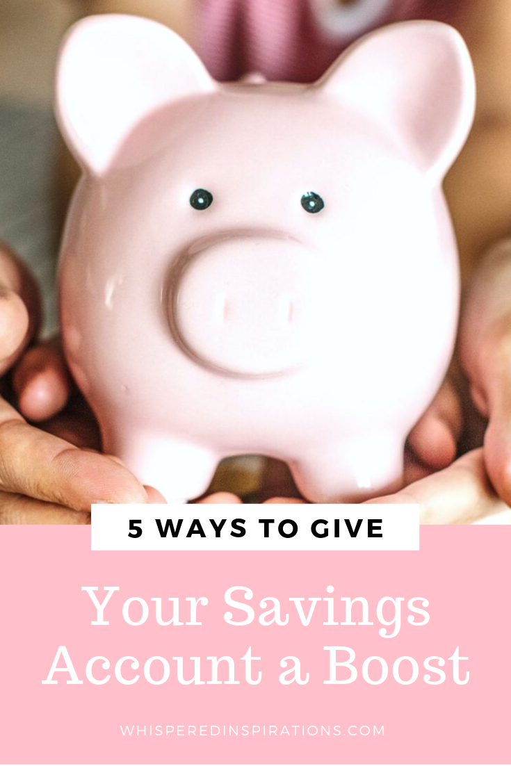 "A couple and their daughter hold a piggy bank together. Coins surround the piggy bank. Below, a banner reads, ""5 ways to give your savings account a boost."""