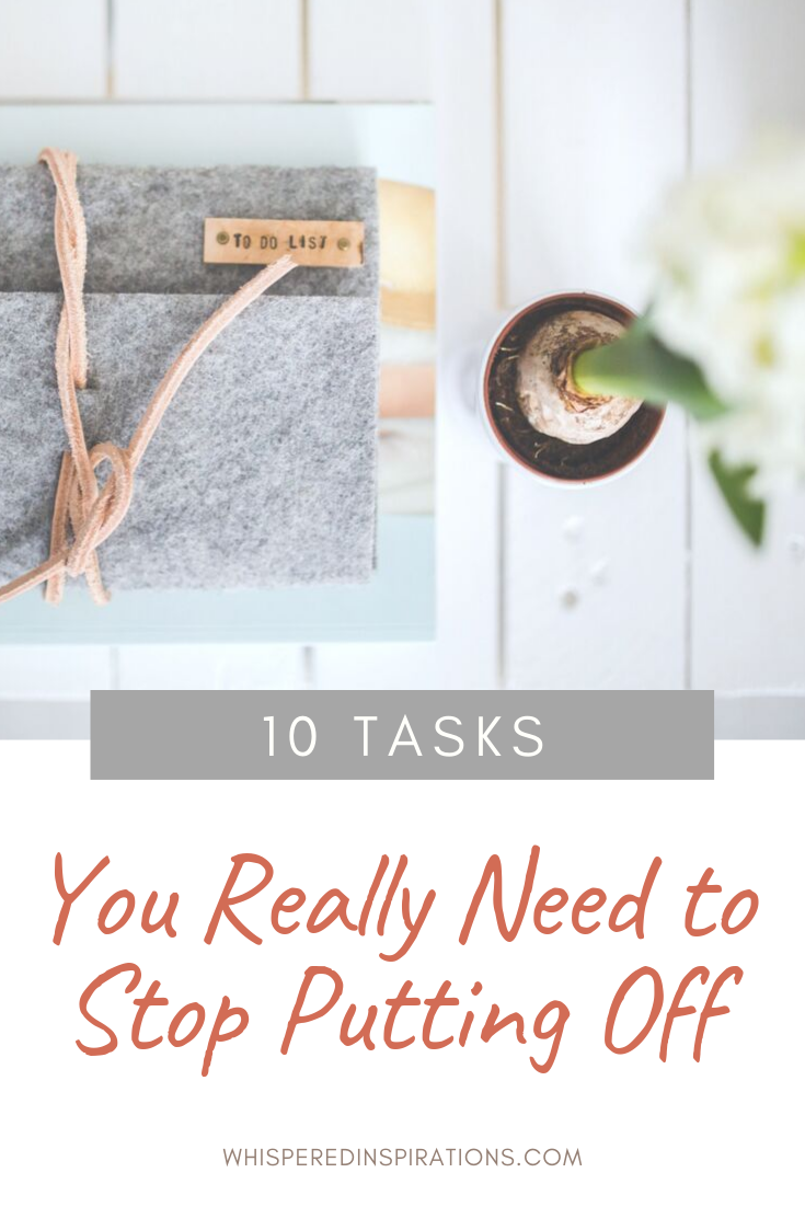 """Grey agenda that says """"to-do"""" list on a white wood table, a flower is seen from a bird's eye view. A banner reads, """"10 tasks you really need to stop putting off."""""""