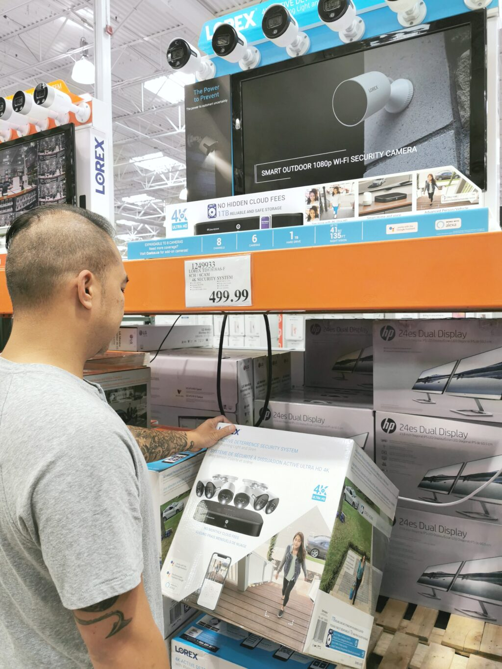 Darasak looks at the security cameras at Costco.