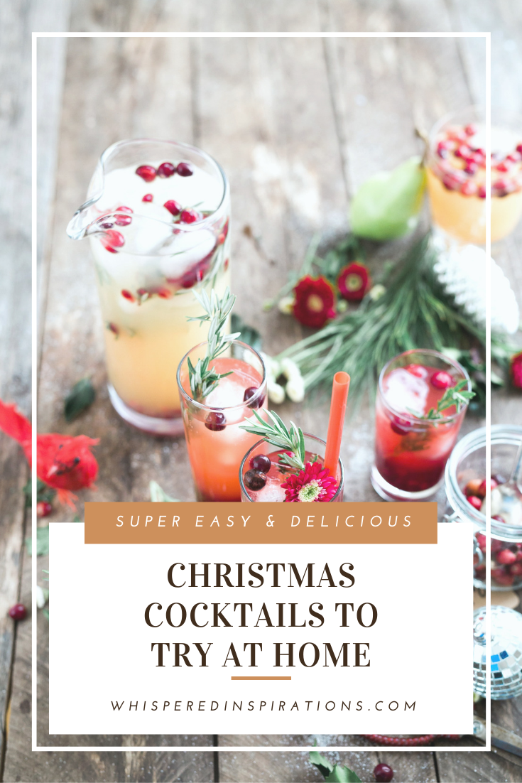"Glasses filled with beautiful cocktails and toppings that are festive for the Christmas season. Other Christmas items surround the drinks on a wooden table. A banner reads, ""Easy and delicious Christmas cocktails to try at home."""