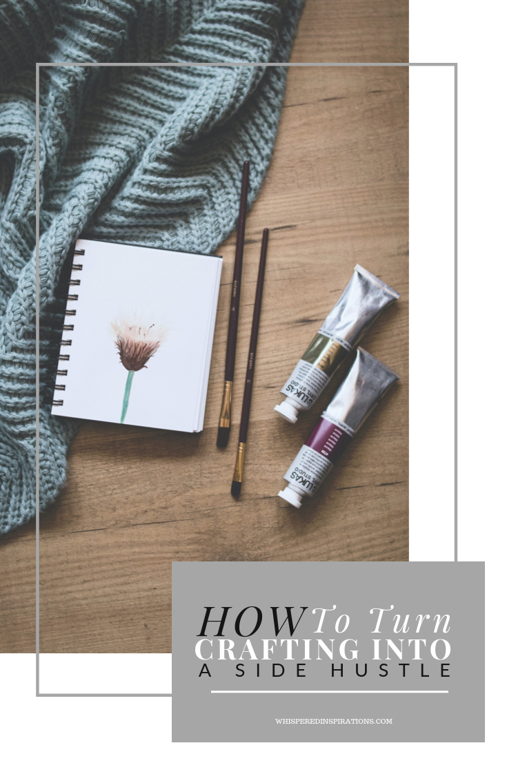"""Throw blanket, notebook, and water colours on a wooden background. A banner that reads, """"how to turn crafting into a side hustle."""""""