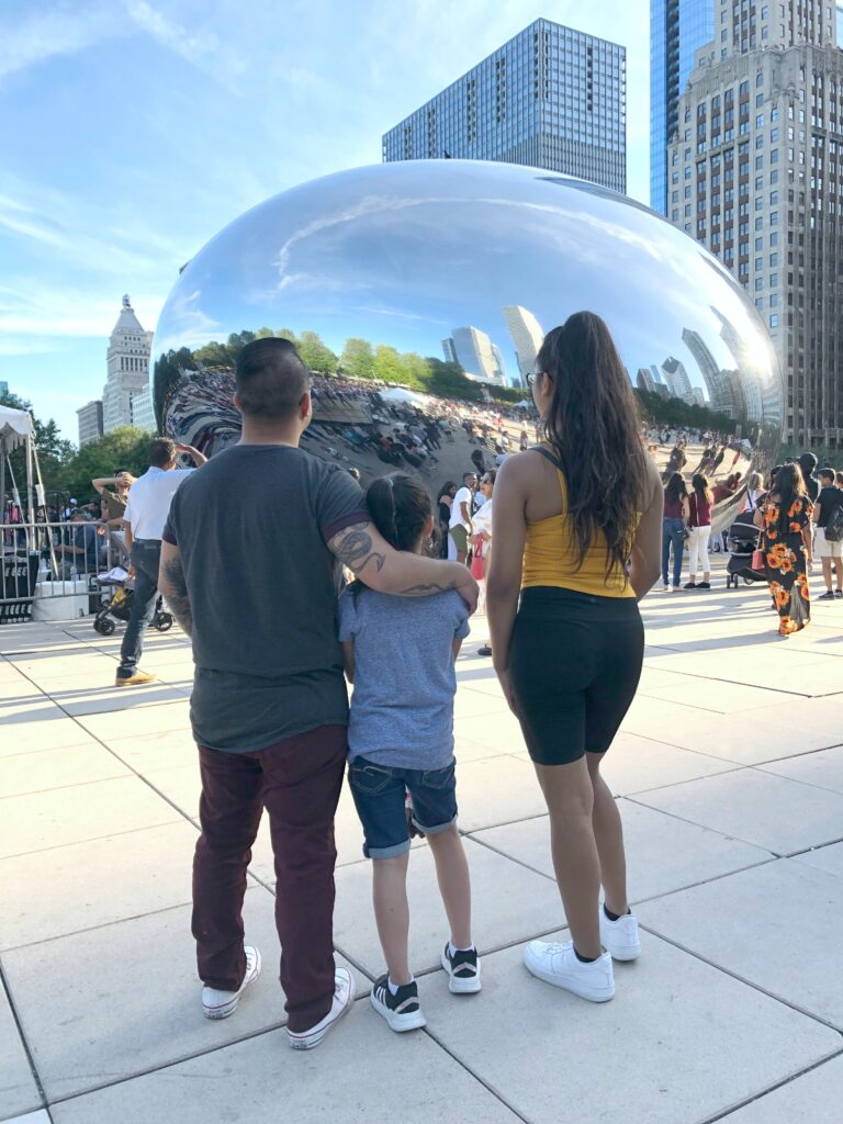 Mimi, Gabby, and Darasak stand in front of the Chicago Bean, aka Cloudgate.