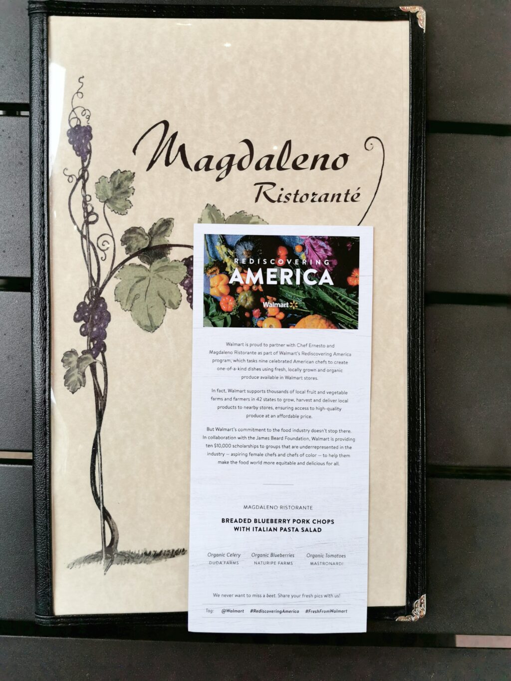 Magdaleno Ristorante menu with 'Rediscovering America' flyer.