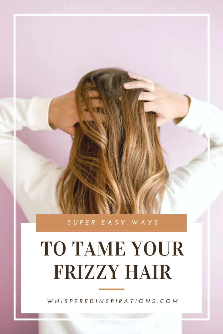 "Girl stands towards a pink wall, with her hands to her head. Her hair is the main focus. A banner below it reads, ""Super Easy Ways to Tame Your Frizzy Hair.'"