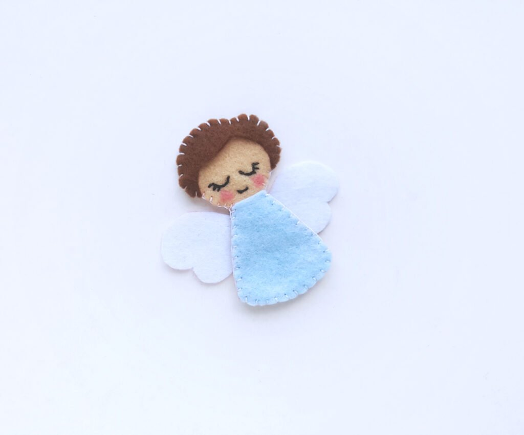 Add angel wings to the little angel.