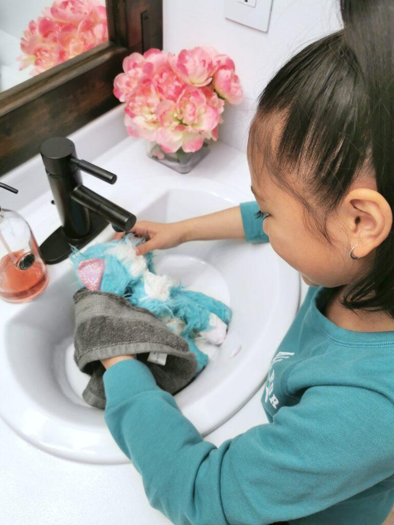 Mimi towel dries her new kitty cat.