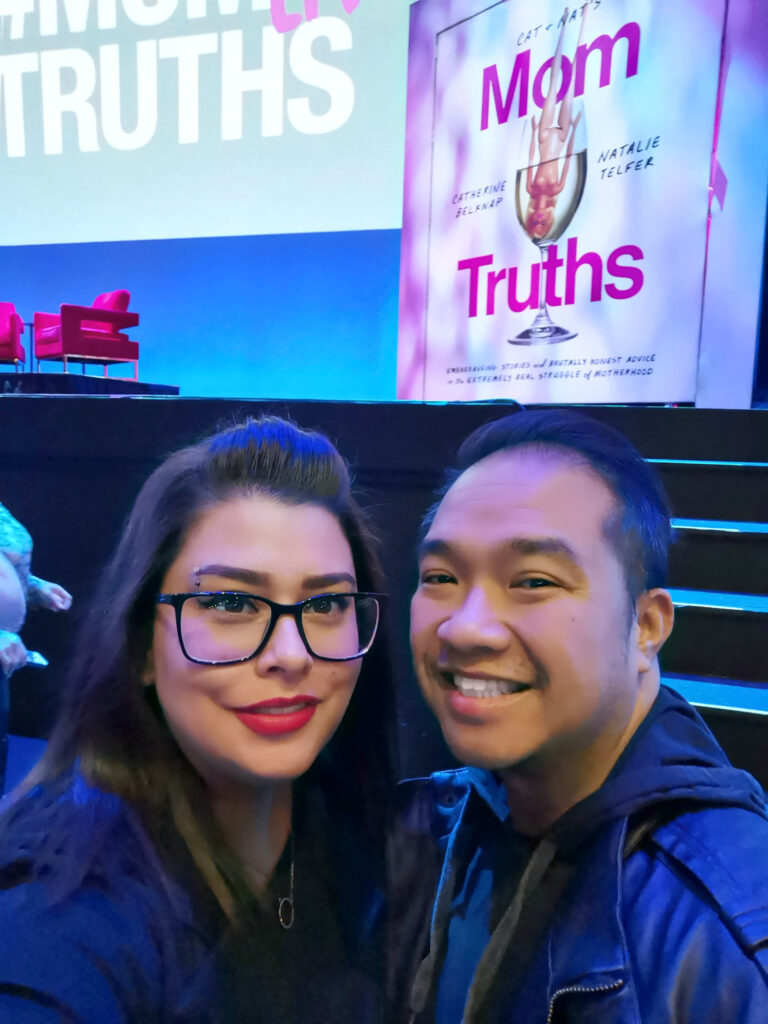 Nancy and Darasak take a selfie in front of the MOMTRUTHS stage in Motorcity Casino's Sound Board.