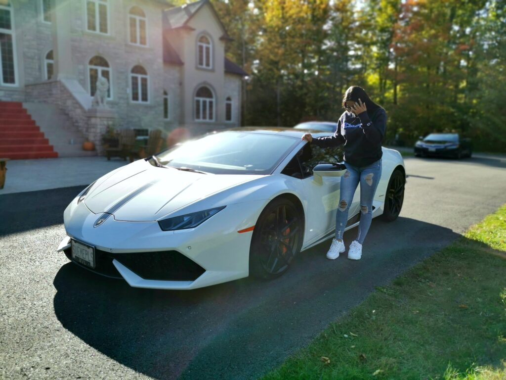 Gabby posing in front of the Lambo in an artistic pose.