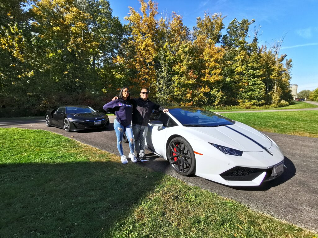 Gabby and Darasak pose in front of the Lambo.