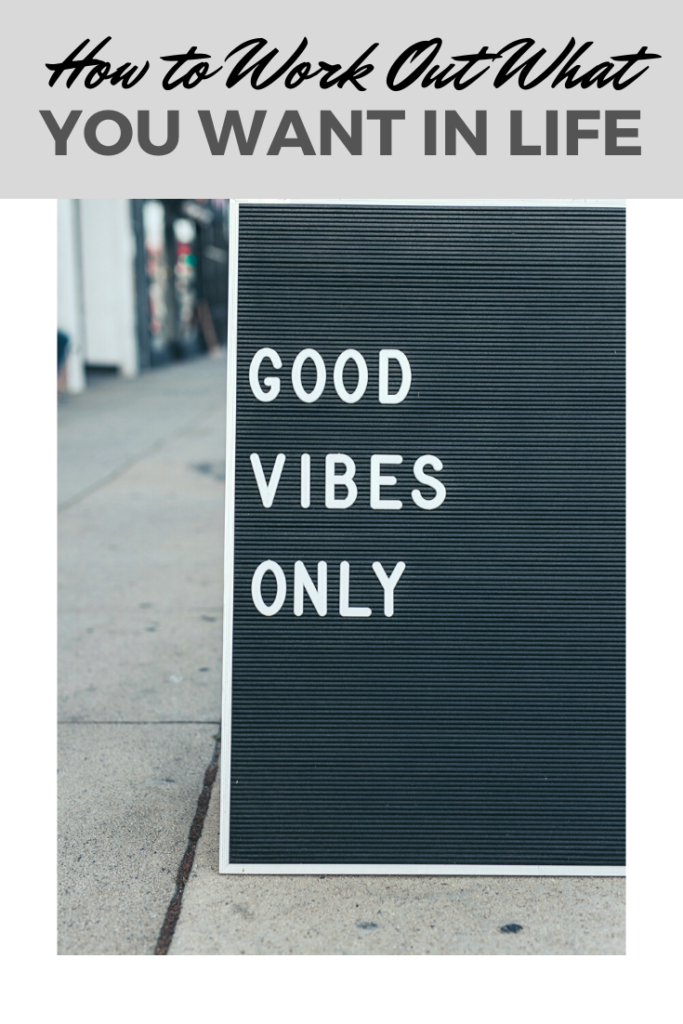 "A banner reads, ""How to Work Out What You Want in Life,"" a picture of A black and white letterboard on a street that says, ""Good Vibes."""