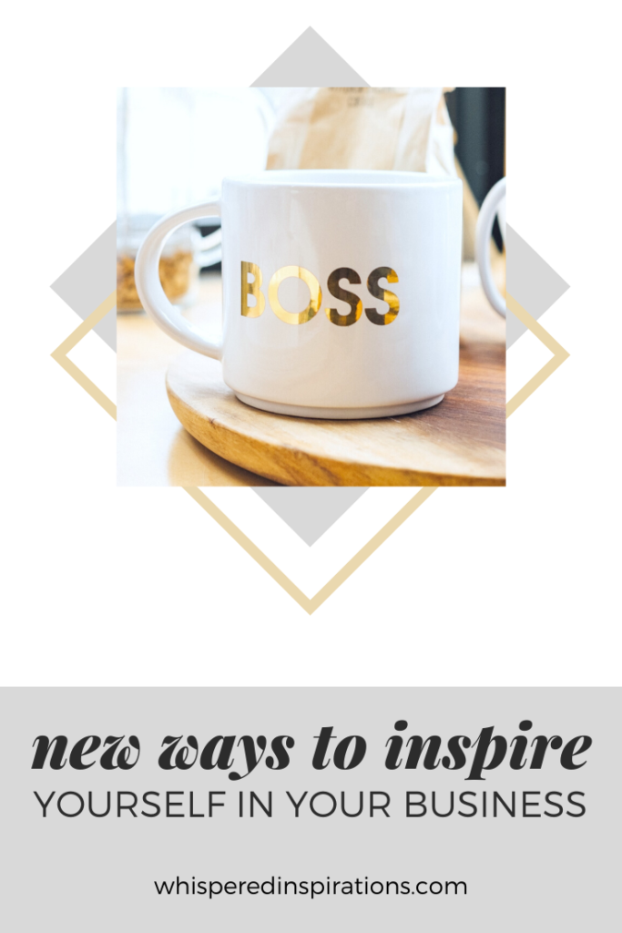 "A banner reads, ""new ways to inspire yourself in your business."" A mug that says Boss, on wooden tray on a kitchen table."