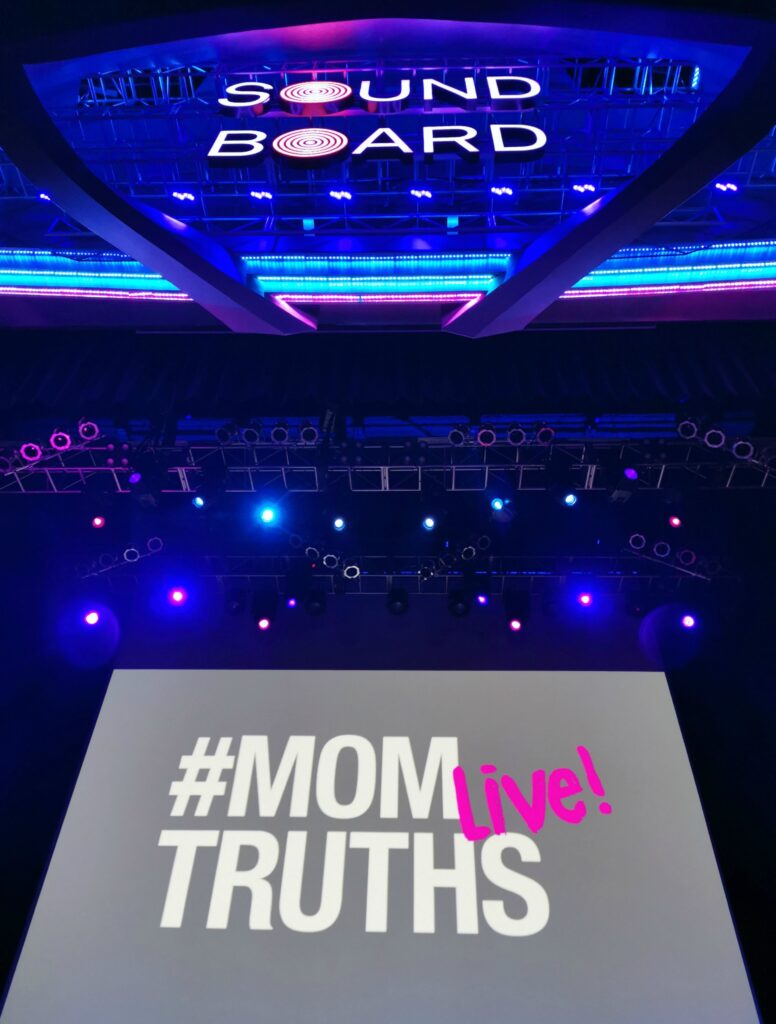 A look of the screen of Mom Truths Live on the Soundboard stage.
