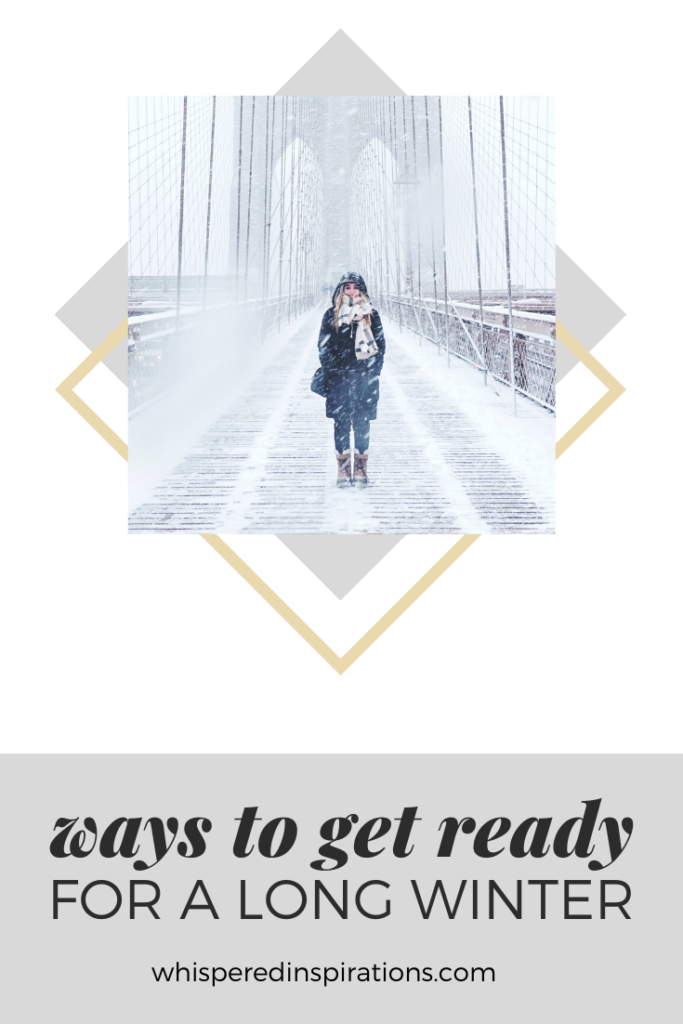 """A girl stands and smiles on the NYC bridge. It's a cold, windy, winter wonderland. A banner reads, """"wasy to get ready for a long winter."""""""