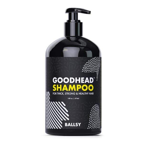 A Goodhead Shampoo bottle is shown, it is black and has yellow and white writing.