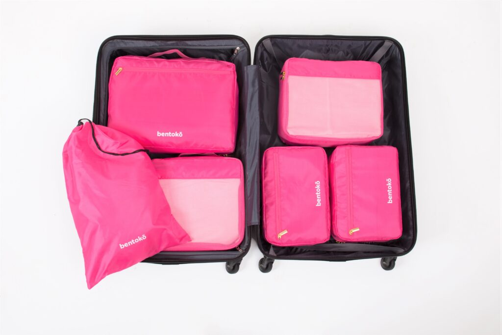 Magenta Bentoko Travel Cases, 6 inside a black luggage.