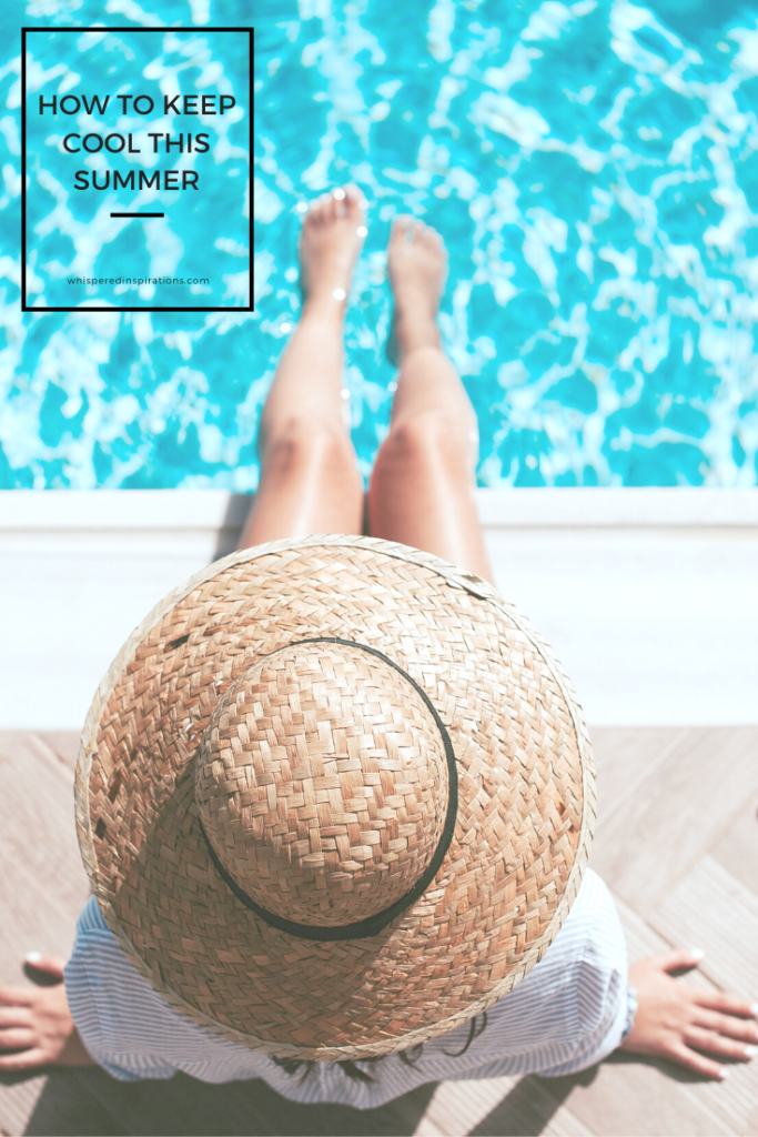 "A woman sits by the edge of a pool. It's a top view of her, only her hat, and legs dipped in the pool are seen. A banner reads, ""How to Keep Cool this Summer."""