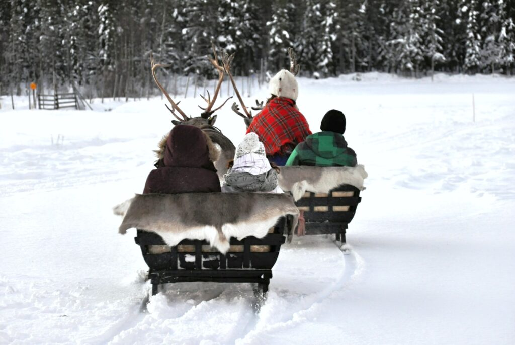 People on a sleigh ride in Lapland.