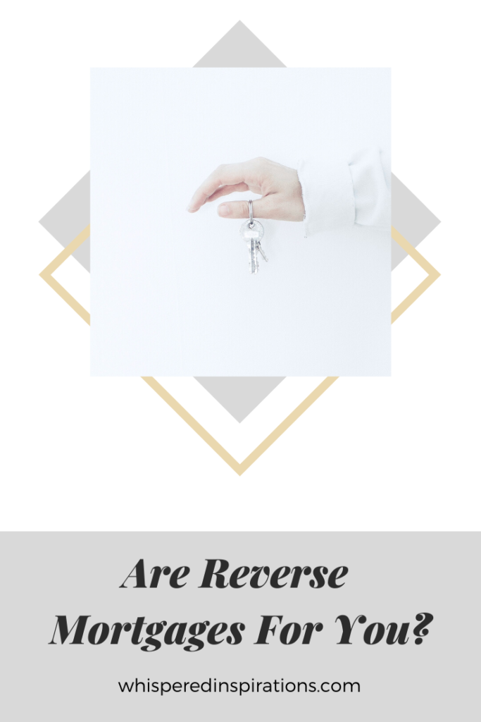"A person's arm and hand are against a white wall and holds a key for a home. A banner below reads, ""Are Reverse Mortgages for You?"""