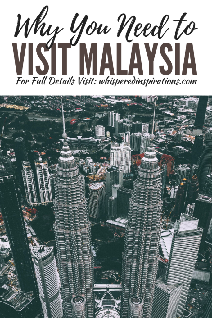 "A banner reads, 'Why You Need to Visit Malaysia,"" a picture of Buildings in Malaysia and urban area."