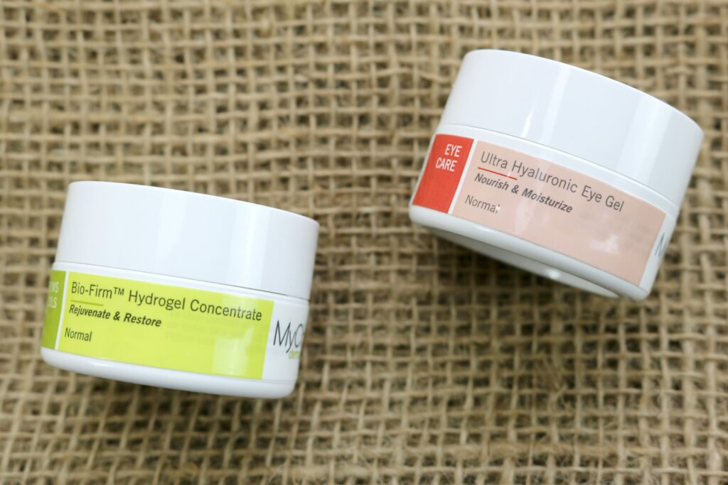 MyChelle Hydrogel and Ultra Hyaluronic Hydrating Eye Gel laying flat, close up.
