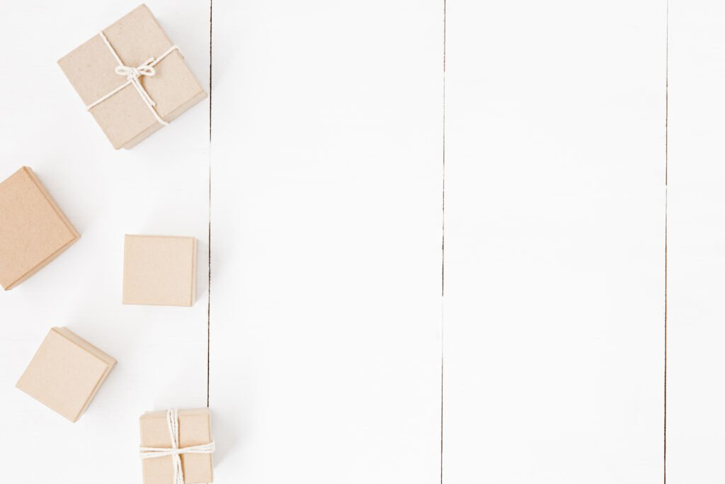 A shiplap wall with butcher paper wrapped gifts and parcels. The style shows a lot about us.