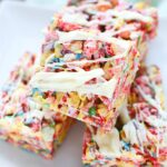 Close up of Fruity Pebbles Squares with white chocolate drizzle.