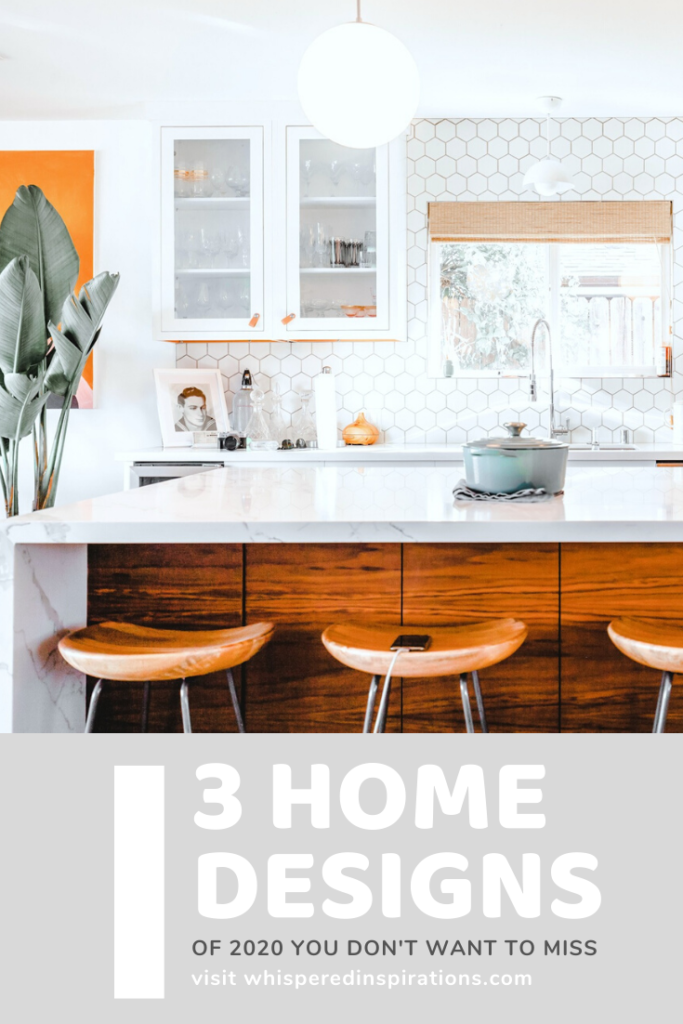 "A modern white kitchen with warmth added in via natural wood. A banner below reads, ""3 Home Designs of 2020 You Don't Want to Miss."""