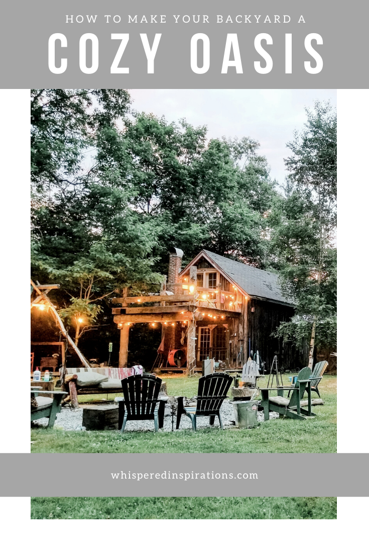 "A beautiful backyard with a fire pit and pergola. There are string lights adorning the homes. A banner reads, ""How to make your backyard a cozy oasis."""