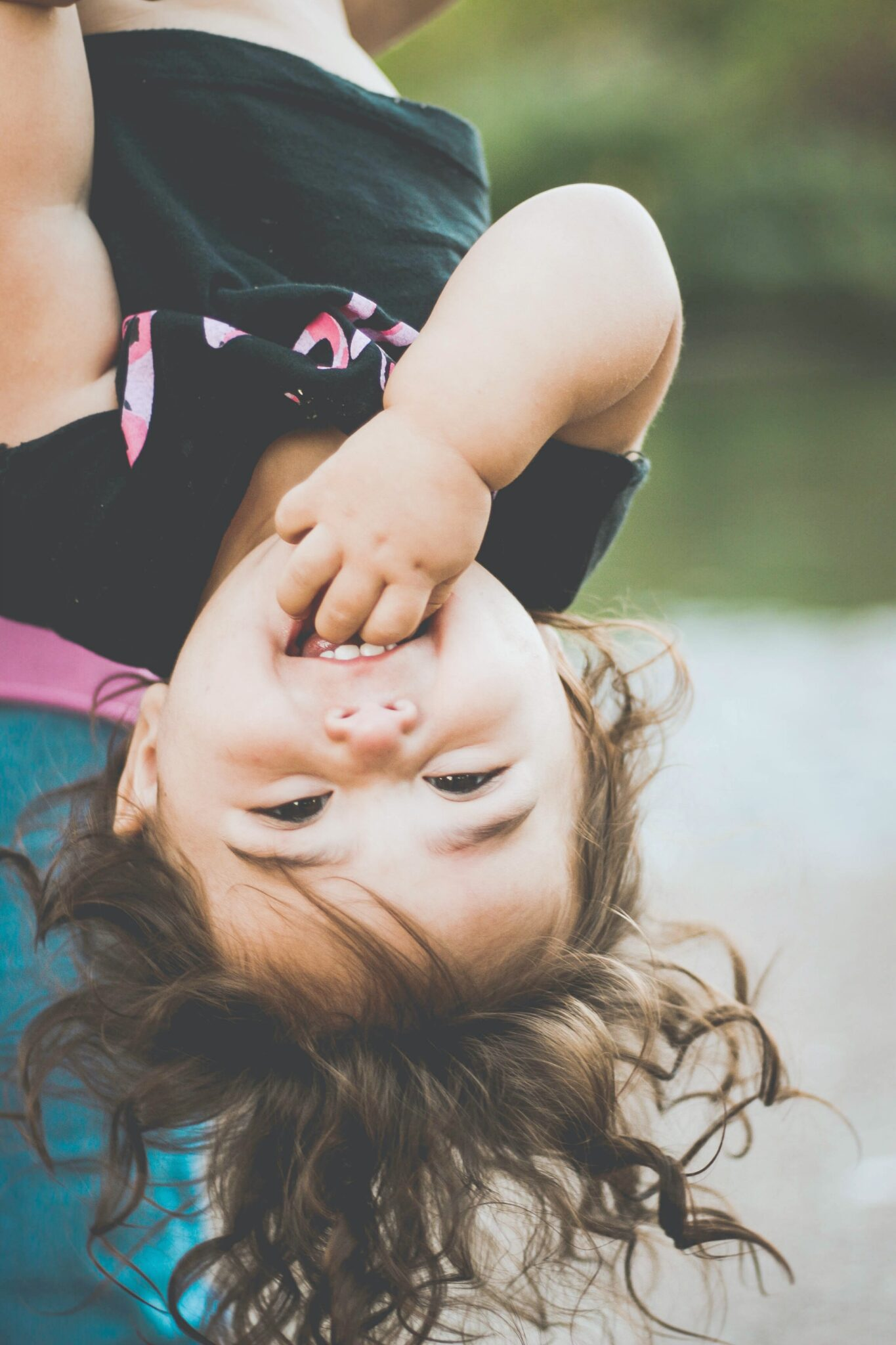 A child is hanging upside down.
