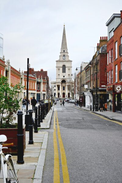 An empty London, England street. Shows a beautiful church and historical buildings.
