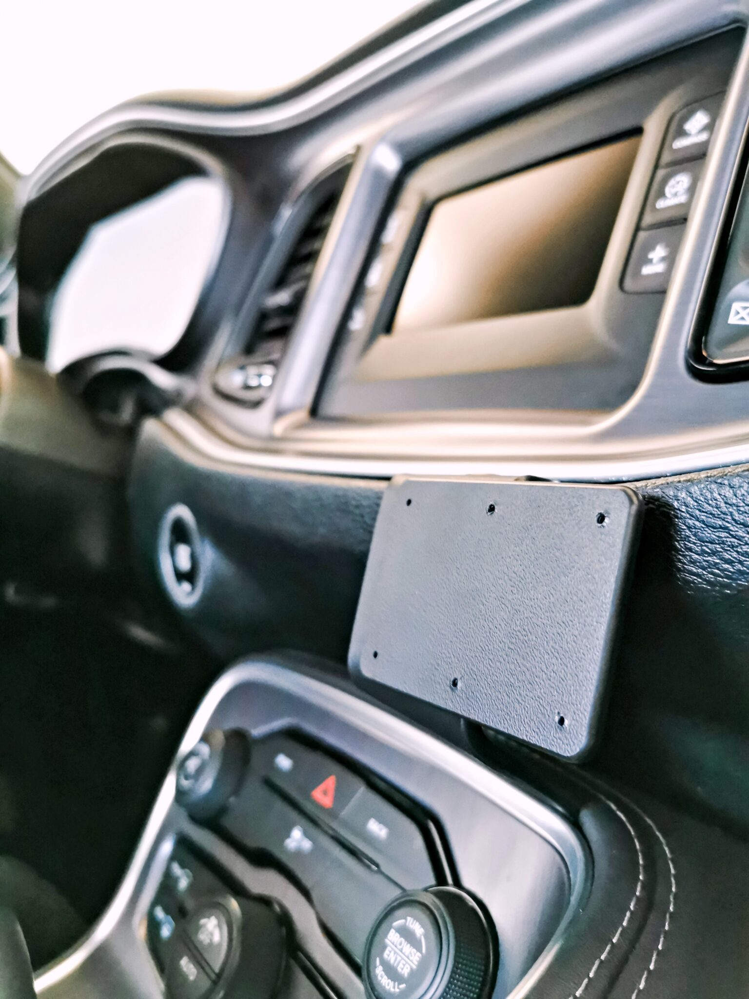The dashboard of the Dodge Challenger underneath the media screen with ProClip mount installed.