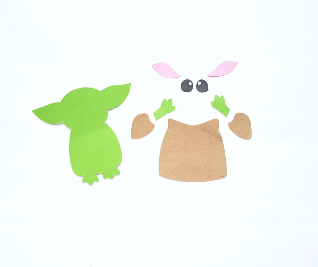 Coloured paper cut out by using the FREE template for Baby Yoda.