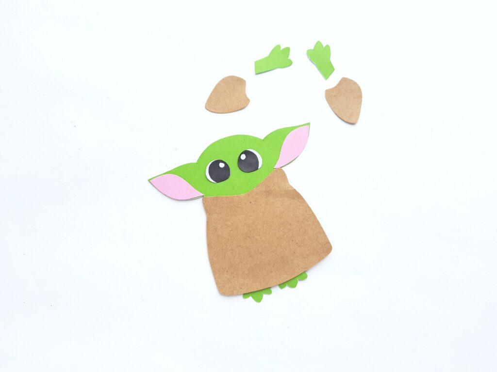 Baby Yoda's eyes placed onto colored paper template.