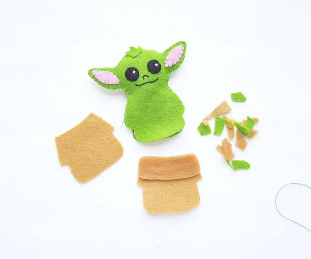 Preparing Baby Yoda's clothes.