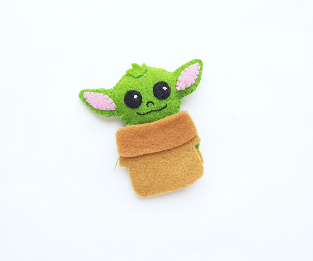 Time to prepare to sew on Baby Yoda's clothes.