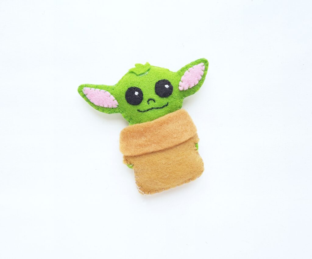 Baby Yoda all sewed up and ready to be enjoyed.